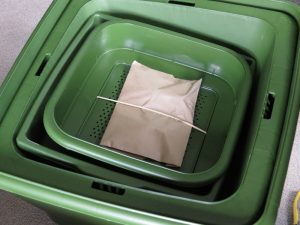 The Hungry Bin is neatly packaged in a cardboard box.