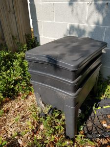 A Worm Cafe worm bin positioned in the shade. A sleek design which sits nicely in any garden.
